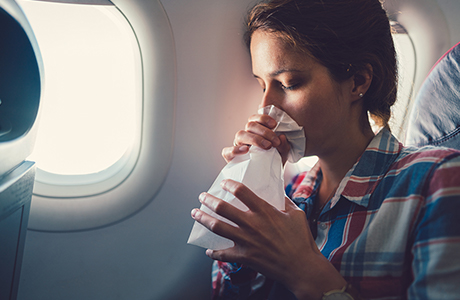 Woman with spit bag on plane