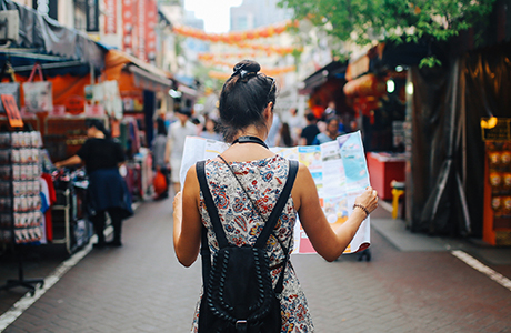 Woman at a market with a map