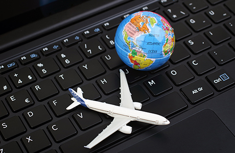 Laptop with plane and globe
